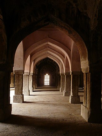 Khirki Mosque - Interior walls and arches restored by conservation action by ASI - Pink colour is distinct