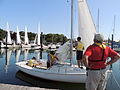 Retired U.S. Navy Cmdr. Dennis Ringle, foreground, a sailing instructor, observes Navy junior ROTC cadets making preparations for getting under way during sail training at Naval Station Newport, R.I., July 12 120712-N-IK959-105.jpg