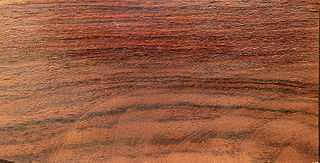 Rosewood One of several types of wood from tropical trees
