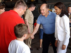 "Robert Duvall - Duvall with future wife Luciana Pedraza (right) shaking hands with a member of ""The Black Stallions"" of Helicopter Combat Support Squadron Four at the Taormina Film Fest in Sicily in June 2003."