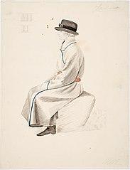 Kansallispukuinen istuva mies