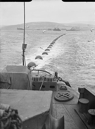 Net laying ship - Image: Royal Navy Vessels Maintain the Boom Defence at Scapa Flow, Scotland, May 1943 A16572