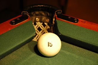 Billiard ball - Russian pyramid ball at a corner pocket. The relative size of the ball and the pocket makes the game very challenging.