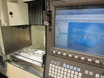 STEP-NC machining on an Okuma CNC at IMTS 2014. STEP-NC at IMTS 2014.jpg