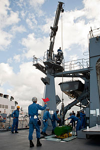 Sailors on JS Bungo load dummy mines into the hold during RIMPAC 2012, -10 Jul. 2012 b.jpg