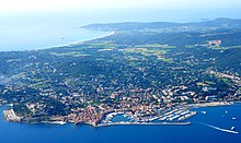 Aerial view of Saint-Tropez, with Pampelonne beach in background and the citadel and the port in the foreground