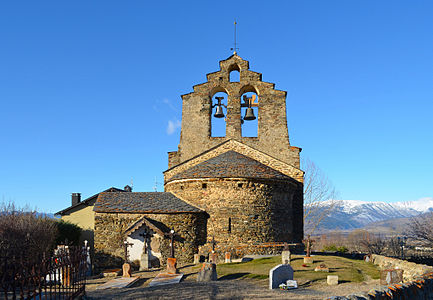 Sainte-Léocadie church, a romanesque church in Pyrénées-Orientales - France. In the foreground, the graveyard. In the background, the snowy en:Pyrenees.