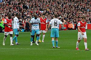 Hérita Ilunga - Ilunga (23) as Arsenal Samir Nasri is about to take a free kick.