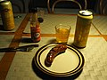 Sausage with hot sauce and beer in Lohja.jpg