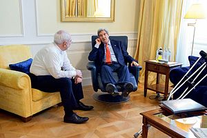 Mohammad Javad Zarif - Zarif with U.S. Secretary of State John Kerry (then recovering from a broken leg) in a one-on-one conversation at the Palais Coburg on July 3, 2015.