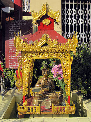 Shin Upagutta - A streetside shrine of Shin Upagutta in downtown Yangon