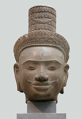 Phnom Bok - Head of Shiva in sandstone from the Phnom Bok in Bakheng style now in Guimet Museum in Paris of the trimurti or trimvarite of Hindu pantheon
