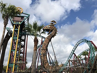 Cobra's Curse - Side view of the King Venymyss statue and elevator lift
