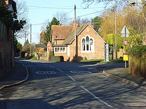 South Moreton - Gothic Revival Lodge (built 1825 as the previous village school) at the junction of the High Street with Church Lane (left) and Clement's Green (right)