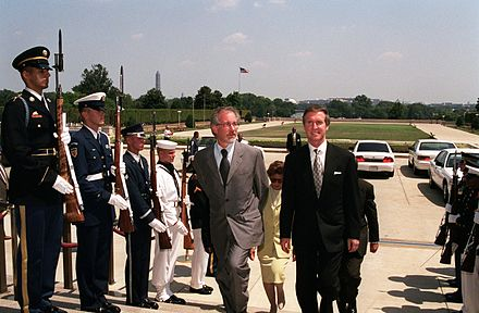 Secretary of Defense William S. Cohen escorts Spielberg through a military honor cordon into the Pentagon. Steven Spielberg 1999 2.jpg