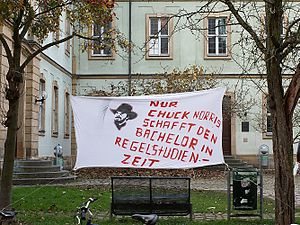 """Chuck Norris facts - Protest banner at the University of Bamberg alluding to Chuck Norris facts (German: """"Only Chuck Norris manages to achieve a bachelor's degree in scheduled time"""")"""
