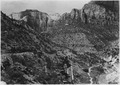 Switchbacks of Mt. Carmel road west of tunnel, looking towards Zion Canyon. West Temple at left. West Temple... - NARA - 520395.tif