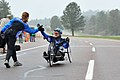 Team Air Force head coach Cami Stock gives a high five greeting to Jeanne Goldy-Sanitate following her completion of the 10-kilometer hand cycle race during the inaugural Warrior Games at the Olympic Training 100513-F-QE915-337.jpg