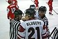 Teodors Blugers and referees, Denmark U20 - Latvia U20, 19.12.2013 in Sanok.jpg