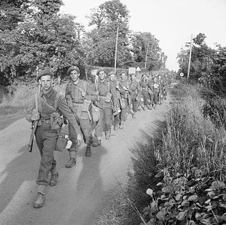 32nd Infantry Brigade (United Kingdom) - Infantrymen of the 1st Battalion, Welsh Guards, Guards Armoured Division, moving up to the front line, July 1944.