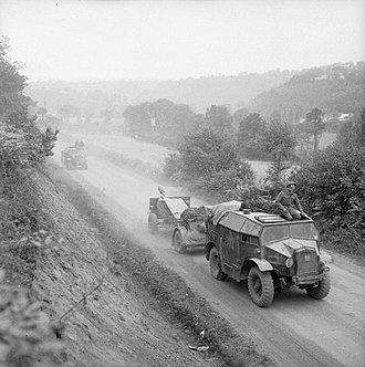 1st Glamorganshire Artillery Volunteers - 25-pounders and Quad tractors advancing in Normandy August 1944.