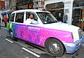 The Chairman of Organising Committee, Commonwealth Games 2010 Delhi, Shri Suresh Kalmadi with a cab having message of the Commonwealth Games Delhi 2010, in London on October 27, 2009.jpg