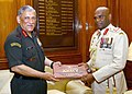The Chief of Army Staff, General Bipin Rawat presenting the Indian Army Coffee Table Book to the Commander of Sri Lankan Army, Lieutenant General N.U.M.M.W. Senanayake, in New Delhi on March 06, 2018.jpg