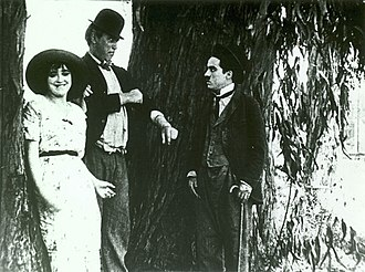 The Fatal Mallet - Mabel Normand, Mack Sennett, and Charles Chaplin in The Fatal Mallet (1914)