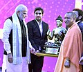 The Prime Minister, Shri Narendra Modi at the inauguration of the UP Investors Summit 2018, in Lucknow, Uttar Pradesh on February 21, 2018. The Chief Minister of Uttar Pradesh, Yogi Adityanath is also seen.jpg