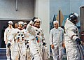 The three Apollo 12 crew men leave the Kennedy Space Center's (KSC) Manned Spacecraft Operations Building (MSOB).jpg