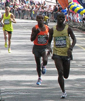 London Marathon - The top three men, Samuel Wanjiru, Tsegay Kebede, and Jaouad Gharib, near the end of the 2009 marathon