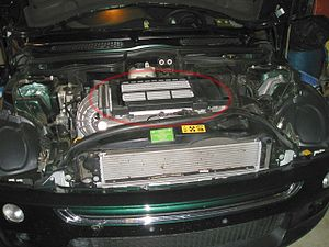 Intercooler - The engine bay of a 2003 MINI Cooper S—the top mounted intercooler is circled in red.