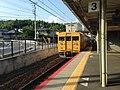 Train bound for Ozuki Station arriving at Chofu Station.jpg