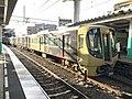 Train for Nishitetsu-Futsukaichi Station at Zasshonokuma Station.jpg