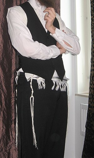 Tallit -  An Orthodox Jewish man wearing a wool tallit katan under his vest.