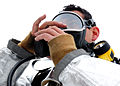 U.S. Air Force Senior Airman Paul Hartmire, an adviser with the 439th Air Expeditionary Advisory Squadron, adjusts his oxygen mask while suiting up for a live fire exercise at the Air University Fire Academy 120115-F-WU210-038.jpg