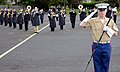 U.S. Marine Corps Staff Sgt. Robert Hungerford, foreground, serving as the drum major for the U.S. Naval Forces Europe (NAVEUR) band, salutes the crowd at the conclusion of a rehearsal run of the NAVEUR band's 120801-N-VT117-1997.jpg