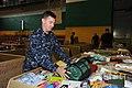 U.S. Navy Chief Mineman Dan Ward places a sleeping bag in a donation box at Naval Air Facility Misawa, Japan, June 27, 2011 110627-N-KK192-089.jpg