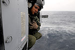 U.S. Navy Chief Naval Air Crewman Julio Grullon monitors the distance to the water during simulated operations on an MH-60S Seahawk helicopter attached to Helicopter Sea Combat Squadron (HSC) 12 in the South 140311-N-GR655-401.jpg
