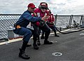 U.S. Navy Command Master Chief Tyrone Willis, left, instructs a hose team during a simulated helicopter crash on the flight deck of the guided missile destroyer USS Ross (DDG 71) in the Atlantic Ocean March 17 140317-N-WX580-050.jpg