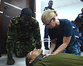 U.S. Navy Hospital Corpsman 2nd Class Teresa Able, right, a lead medical facilitator, demonstrates to boarding team members from the Seychelles Coast Guard how to position a neck brace during a first-aid 131112-N-EZ054-132.jpg