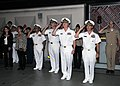 U.S. Navy Rear Adm. Mark L. Tidd, foreground, second from right, chief of Navy chaplains, salutes during the playing of the national anthem during a capping ceremony next to USS Trayer (BST 21), with Recruit 120803-N-IK959-400.jpg