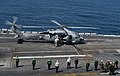 U.S. Navy Vice Adm. David H. Buss, center, the commander of Naval Air Forces, arrives aboard the aircraft carrier USS Carl Vinson (CVN 70) May 7, 2013, in the Pacific Ocean 130507-N-HD510-062.jpg