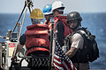 U.S. Sailors assigned to the guided missile destroyer USS Stockdale (DDG 106) are hoisted from the water in a rigid-hull inflatable boat during small-boat operations in the U.S. 5th Fleet area of responsibility 130522-N-HN991-072.jpg
