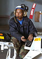 US Navy 030309-N-1328C-502 Airman Dewey Anderson from Pascagoula, Miss., drives a spotting dolly while moving aircraft around the hangar bay aboard USS Theodore Roosevelt (CVN 71).jpg