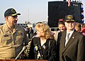 US Navy 030415-N-2903K-003 Cmdr. James M. Kuzma (left), Commanding Officer of the fast attack submarine USS Boise (SSN 764) is greeted by his wife Karen and Acting Secretary of the Navy.jpg