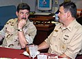 US Navy 030418-N-4048T-046 Master Chief Petty Officer of the Navy Terry Scott discusses the USS Kearsarge (LHD 3) contributions to Operation Iraqi Freedom with Command Master Chief Edward Myers, Jr.jpg