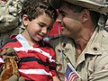 US Navy 030609-N-0728B-001 Lt. Cmdr. Richard Savarino shares a joyous moment of reunion with his son shortly after personnel from Fleet Hospital Three (FH-3) returned to Naval Hospital Pensacola from deployment in support of Op.jpg