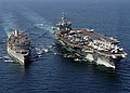 US Navy 031111-N-6259P-006 The guided missile cruiser USS Gettysburg (CG-64) and nuclear-powered aircraft carrier USS Enterprise.jpg