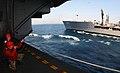 US Navy 040507-N-3005E-024 Gunner's Mate Seaman Kyle Vanleuven, of Phelan, Calif., watches as Aviation Ordnanceman 1st Class Jackson Bennet, of Little Rock, Ark., shoots the shot line from the hangar bay aboard USS Ronald Reaga.jpg
